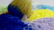 Abstract backgrounds slow motion makeup brush falling beauty colorful powder