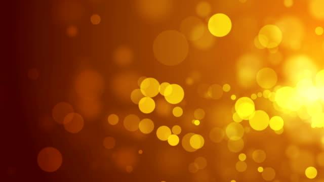 Abstrakte bokeh goldene Partikel