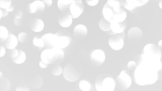 Abstract glittering white bokeh background