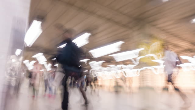 Abstract shot of moving people at subway station in New York