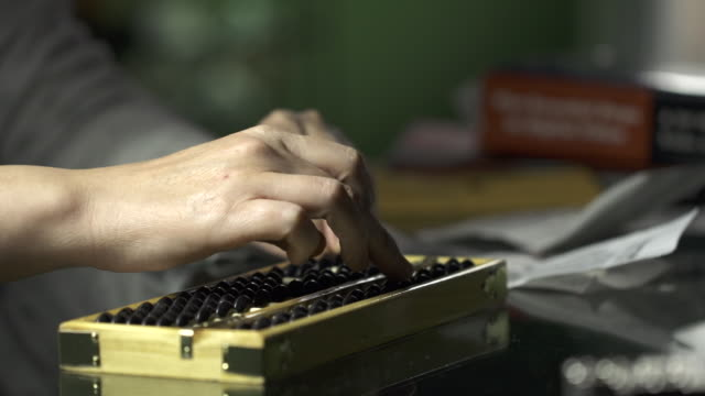 Accountant Using Traditional Chinese Maths Tool Abacus