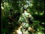 BV Aceh separatist guerillas away thru woods Guerillas towards past