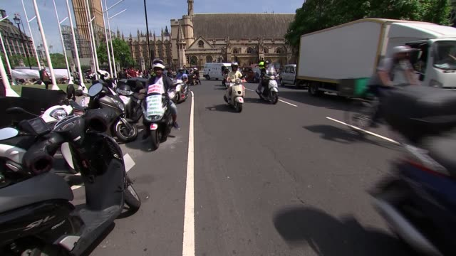 Delivery riders protest in Parliament Square ENGLAND London Westminster Parliament Square EXT Various shots of protesting delivery riders on...