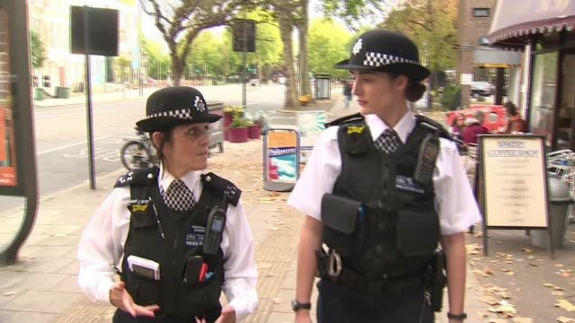 People caught carrying acid twice in public could face jail sentence London EXT Two women police officers patrol on foot along city centre road/...