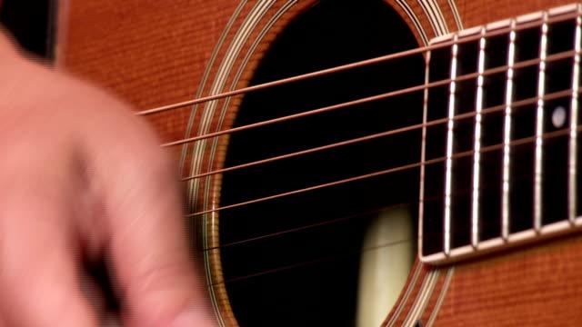 Akustische Gitar Spieler-Nahaufnahme