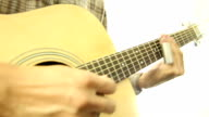acoustic guitarist play solo with metal slide
