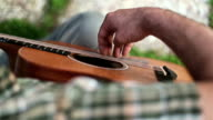 Acoustic guitarist playing chords, close-up