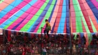 Acrobate doing trapeze inside a circus tent beside in Dhaka Bangladesh on November 29 2016 Circus is a popular form of entertainment for different...