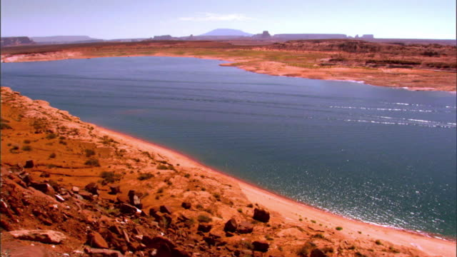 WS PAN across Lake Powell  in Glen Canyon National Recreation Area with speed boats and house boats on the lake / Page, Arizona, USA