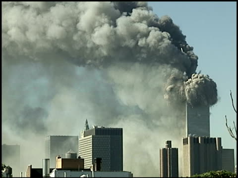 PAN across large smoke cloud to burning WTC Tower 1 after Tower 2's collapse / Tower 1 moments before its collapse / Tower 1 collapses from top down...