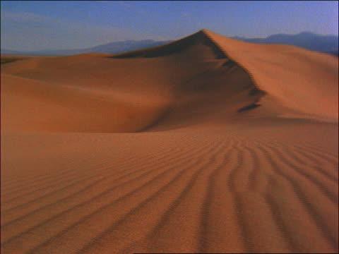 PAN across sand dunes / Death Valley, California