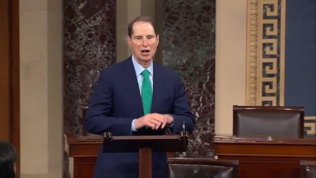 Acting as the presiding officer Alaska Senator Dan Sullivan allocates time to Oregon Senator Ron Wyden and Pennsylvania Senator Pat Toomey to debate...