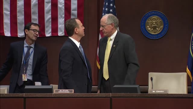 Acting Chair of a Russia Task Force Mike Conaway on the House Select Intelligence Committee and ranking Democrat Adam Schiff speak on the dais after...