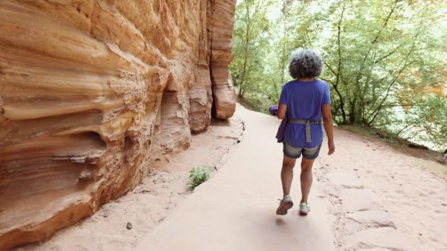 4K UHD: Active Senior Hiking through a Canyon