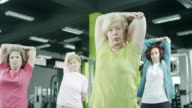 Active senior women in the gym