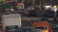 Active shot of traffic on east tremont avenue in the bronx near washington ave and a junction to I95 North during the day