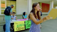 MS, activist encouraging students to sign petition on campus, San Antonio, Texas, USA