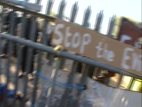Activists are chained to each others to protest against the eviction of travellers from Dale Farm