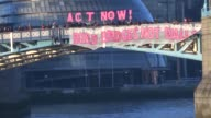 Activists from Bridges not Walls unfurl a banner on Tower Bridge in London to coincide with the inauguration of Donald Trump