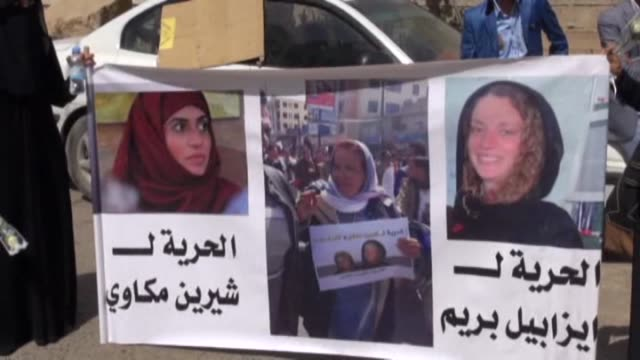Activists gather in front of Commission of Human Rights building in Sanaa Yemen on March 9 2015 to demand the release of Isabelle Prime 30 year old...