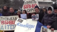 Activists hold banners 'Save Aleppo''Putin get out of Syria and Ukraine''Putin and Assad are killers of children' and 'Syrian refugees are welcome in...