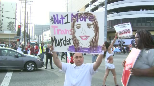 Activists to Protest Ongoing Murders of Transgender Women in Los Angeles Protesters shut down a busy intersection outside the Beverly Center during...