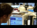 Activity in busy stockbrokers office