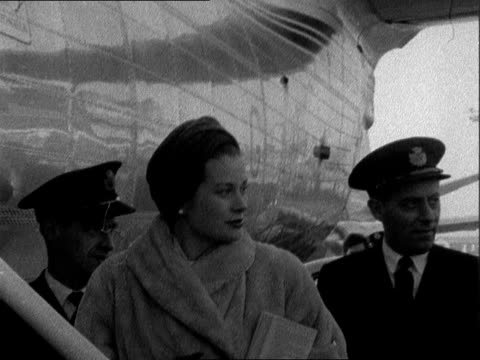 Prince Rainier and Princess Grace / Ingrid Bergman ENGLAND London London Airport EXT Prince Rainier III Prince of Monaco and Princess Grace along...