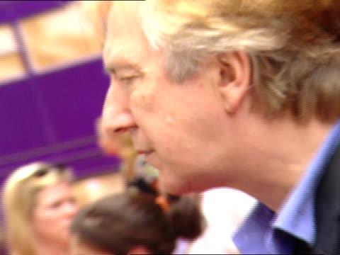 DAY Actor Alan Rickman standing on red carpet near Radio City Music Hall talking to press reporter people BG