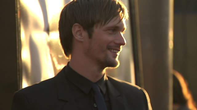 HD Actor Alexander Skarsgard on red carpet outside the Cinerama Dome posing for press photographs