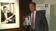 Actor and former California governor Arnold Schwarzenegger signs autographs on release of his memoirs Total Recall My Unbelievably True Life Story...