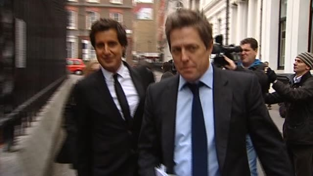 Actor Hugh Grant on his way to testify for the Levenson Inquiry on media ethics