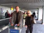 Actor Kelsey Grammer arrives at Heathrow from Los Angeles with wife Camille Grammer / The star of Cheers and Frasier pushes trolley holding inflight...