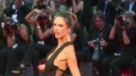 Actor Mark Ruffalo director Thomas McCarthy and model Alessandra Ambrosio walk the red carpet in Venice for the premiere of Spotlight which focuses...