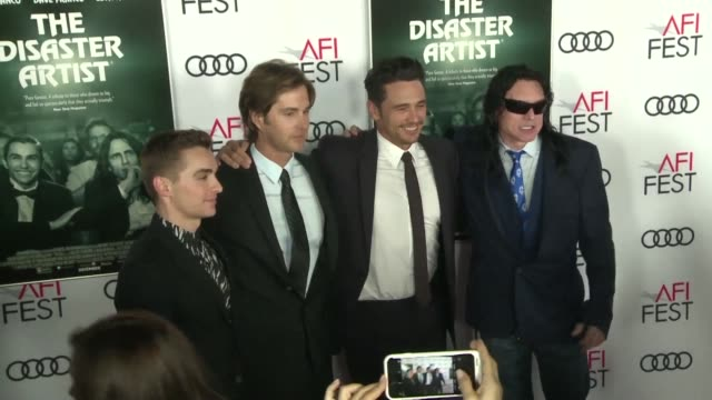 Actordirector James Franco and The Disaster Artist cast walk on the red carpet for the presentation of the film at the AFI Film Festival in Hollywood...