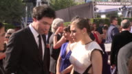 MS Actors Alex Karpovsky and Zosia Mamet greeting each other with hug talking posing and waving on the red carpet at the Nokia Theater LA Live