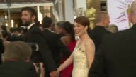 Actors directors and other celebrities attempted to avoid rain as they arrived on the red carpet ahead of the 87th annual Academy Awards