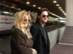 Actors Goldie Hawn and Kurt Russell walk out of Heathrow airport to waiting car The showbiz couple had arrived on a flight from USA