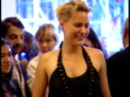 Actress Aimee Mullins female friend entering on red carpet at The Paris Theatre in NYC Mullins telling friend to come out to pose for photographs for...