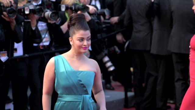 Actress Aishwarya Rai posing for paparzzi along the red carpet at Grand Theater Lumiere