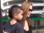 Actress Angelina Jolie flies into Heathrow with adopted Cambodian son Maddox aged 2 She carries him outside terminal building into a waiting vehicle