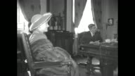 Actress Anne Baxter and Director Alfred Hitchcock meet the Lieutenant Governor of Quebec Gaspard Fauteux for the PR trip of 'I Confess'