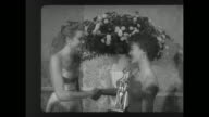 MS actress Grace Kelly presents the Audience Award for best actor to actress Natalie Wood who accepts it on behalf of the late James Dean / WS...