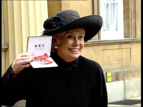 London Buckingham Palace GVS Liz Dawn along with others Dawn poses for press holding MBE investiture Dawn stands wearing MBE Dawn standing with...