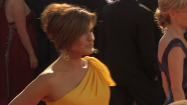 Actress Mariska Hargitay posing on crowded red carpet outside Nokia Theatre for press photographs