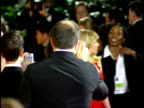 Actress Scarlett Johansson walking through crowded red carpet at Beverly Hilton hotel walking over to press reporters