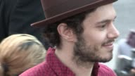 Adam Brody greets fans while arriving at the Lovelace Premiere at the Egyptian Theatre in Hollywood 08/05/13