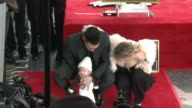 Adam Levine and Behati Prinsloo at Hollywood Walk Of Fame on February 10 2017 in Hollywood California