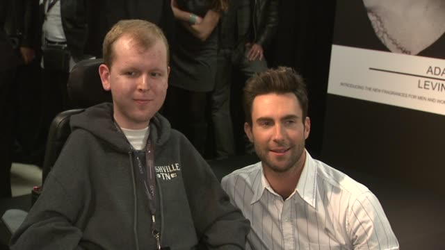 Adam Levine and fan at Launch Of Adam Levine Signature Fragrances At Macy's Herald Square at Macy's Herald Square on February 15 2013 in New York New...