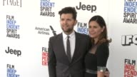 Adam Scott and Naomi Scott at the 2017 Film Independent Spirit Awards Arrivals on February 25 2017 in Santa Monica California
